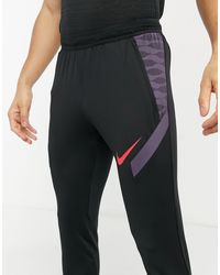 Nike Football Joggers negros y violetas Strike 21