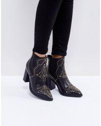 30b4f15d3db Himmel Studded Heeled Boots - Black