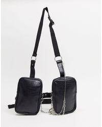 ASOS – Tasche aus schwarzem Kunstleder mit Riemen- und Kettendetail