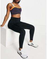 Flounce London Leggings deportivos s con cordón ajustable y efecto moldeador en el trasero - Negro