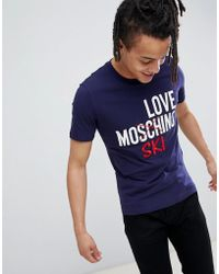 Love Moschino - T-shirt blu con logo ski - Lyst