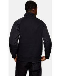 TOPMAN – Gestepptes Sweatshirt mit Raglanärmeln und kurzem Reißverschluss - Schwarz
