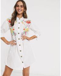 ASOS - Vestido corto holgado con diseño abotonado, cuello henley bordado y lazos anudados en las mangas en blanco - Lyst