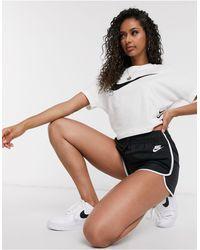 Nike – e Shorts aus Webstoff mit hohem Bund - Schwarz