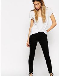 0e06641bfb01 Asos Whitby Low Rise Skinny Jeans In Black With Crochet Hem in Black ...
