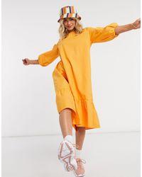 Monki July - Robe babydoll longue volumineuse en coton biologique - Jaune