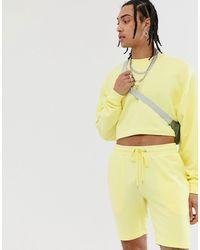 ASOS – Kurzes Oversize-Jogginganzug mit kurzer Shorts - Gelb