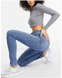 ASOS ASOS DESIGN Tall Hourglass - Jean skinny taille haute effet sculptant et rehaussant à délavage moyen - Bleu