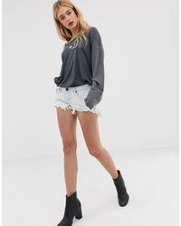 One Teaspoon – Bonita – Tief sitzende Shorts mit offenem Saum - Blau
