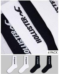 Hollister Confezione da tre paia di calzini sportivi neri e bianchi con logo - Nero