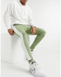 ASOS Skinny sweatpants With Side Stripe - Green