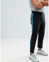 ASOS Pantaloni skinny cropped eleganti neri con riga laterale e zip frontale con tiralampo ad anello - Nero