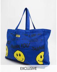 Chinatown Market Tote bag à motif smiley déformé - Bleu