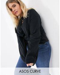 ASOS ASOS DESIGN Curve - T-shirt oversize à manches longues - Noir