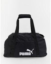 PUMA - Phase Small Carryall In Black - Lyst