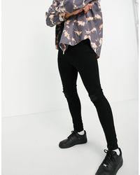 The Couture Club Jean super skinny con strappi e rammendi nero corvino