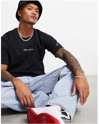 Champion T-shirt nera oversize con logo piccolo - Nero