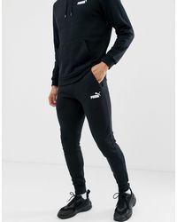 PUMA – Essentials – Schmal geschnittene Jogginghose mit kleinem Logo - Schwarz