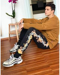 Criminal Damage Joggers With Barb Wire Flame Print - Multicolour