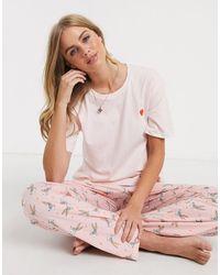 "ASOS Pigiama T-shirt e pantaloni di Bugs Bunny con scritta ""Somebunny loves me"" - Rosa"