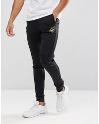 Kings Will Dream - Skinny Joggers In Black With Gold Logo - Lyst
