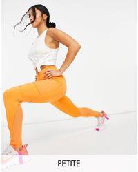ASOS 4505 Leggings con icono y detalle - Naranja