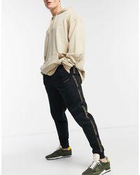 Calvin Klein Черные Джоггеры С Манжетами И Логотипом По Бокам Gold Capsule-черный Цвет