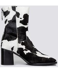 INTENTIONALLY ______ Pg Moo Boot - Black