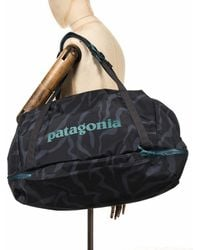 Patagonia Planing 55l Duffel Bag - Tiger Tracks Camo: Ink Black Colour