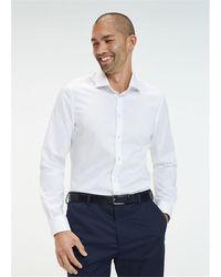 Tommy Hilfiger Camicia Slim Fit In Morbido Cotone, Colletto Francese Con Logo Ricamato Sulla Manica, 96% Cotone 4% Elastane - White