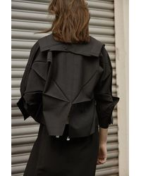 132 5. Issey Miyake Origami Jacket - Black