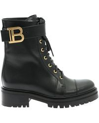 Balmain Metal Logo Ankle Boots In Black