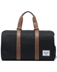 Herschel Supply Co. Herschel Novel Duffle Black Tan Synthetic Leather