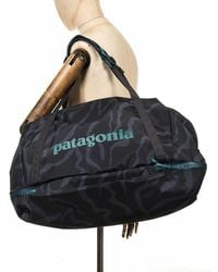 Patagonia Planing 55l Duffel Bag - Tiger Tracks Camo: Ink Black Colour