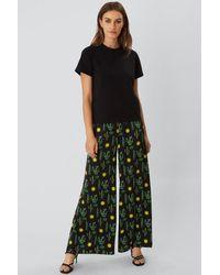 PHOEBE GRACE PEGGY Wide Leg Palazzo Trouser In Black Cactus Print