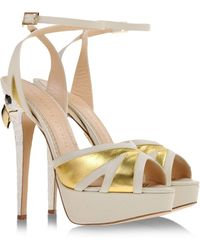 Charlotte Olympia Sandals gold - Lyst