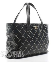 Chanel Pre-Owned Black Leather Large Surpique Tote Bag black - Lyst