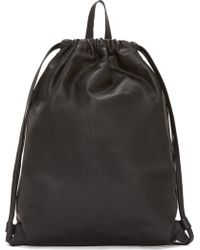 PB 0110 - Black Unstructured Drawstring Backpack - Lyst