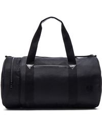 Stussy - Nylon Barrel Bag - Lyst