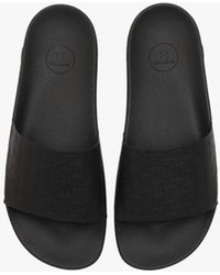 Balmain Leather Calypso Sandals With Embossed Monogram - Black