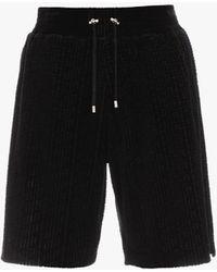 Balmain E Shorts aus Samt mit geprägtem -Monogramm - Schwarz