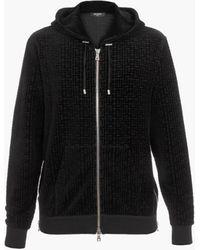 Balmain Es Sweatshirt aus Samt mit geprägtem -Monogramm - Schwarz