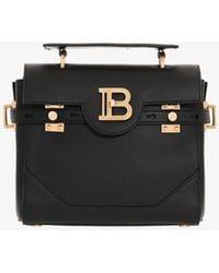 Balmain Small B-buzz 23 Smooth Leather Top Handle Bag With Logo Plaque - Black