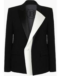 Balmain Doppelreihiges Jackett aus Krepp und Satin in Schwarz und Weiß
