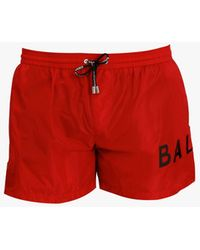 Balmain Swimming Briefs With Black Logo Print - Red