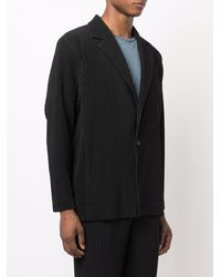 Issey Miyake Coats Black