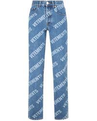 Vetements All Over Logo Magic Fit Denim Jeans - Blue