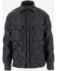 Dolce & Gabbana Coats - Black
