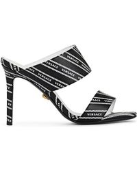 Versace - Logo-print Leather Mules - Lyst