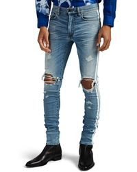 Amiri Track Distressed Striped Skinny Jeans - Blue